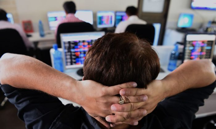 An Indian stock trader looks at share prices during intra-day trade at a brokerage house in Mumbai on February 6, 2018. (Indranil Mukherjee /AFP/Getty Images)