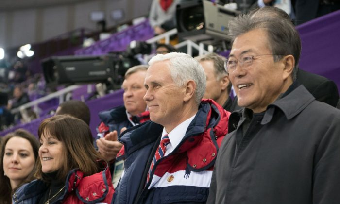 Vice President Mike Pence (C), wife Karen, and President of South Korea Moon Jae-in watch short track speed skating at Gangneung Ice Arena in Gangneung, South Korea, Feb. 10, 2018. (Carl Court/Getty Images)