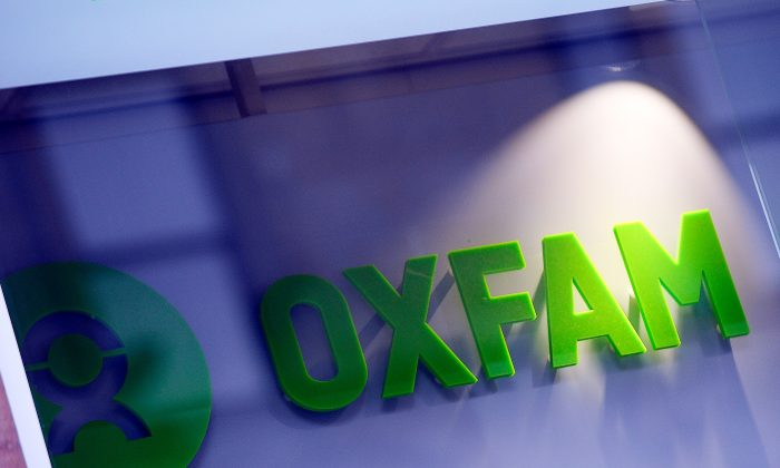 The logo on the front of an Oxfam bookshop is photographed in Glasgow on Feb. 10, 2018. 