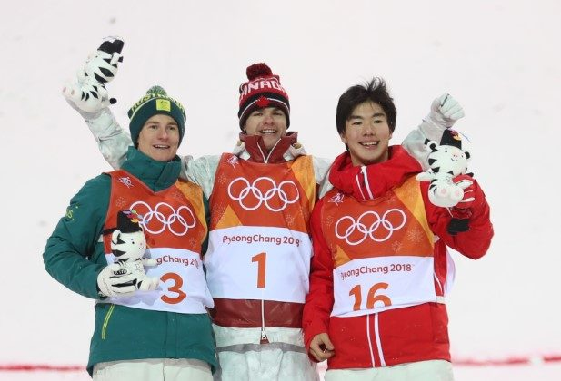 Gold medalist Mikael Kingsbury of Canada, silver medalist Matt Graham of Australia and bronze medalist Daichi Hara of Japan during victory ceremony Freestyle Skiing Men's Moguls Final at the Pyeongchang 2018 Winter Olympics on Feb. 12, 2018. (Reuters/Mike Blake)