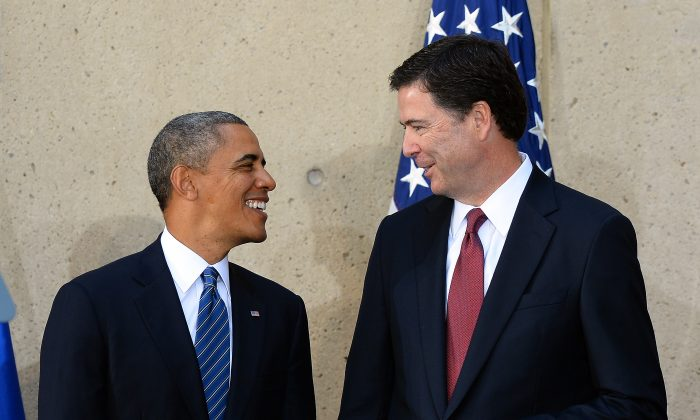 President Barack Obama (L) talks with FBI director James Comey on Oct. 28, 2013. (JEWEL SAMAD/AFP/Getty Images)