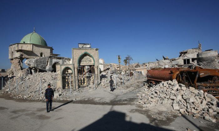 Members of the Iraqi forces stand outside the destroyed Al-Nuri Mosque in Mosul's Old City, on January 8, 2018, six months after troops seized the country's second city from ISIS. (Ahmad Al-RubayeE/AFP/Getty Images)