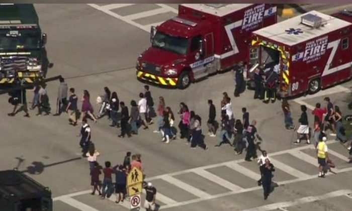 Students are evacuated from Marjory Stoneman Douglas High School during a shooting incident in a still image from video in Parkland, Florida, Feb. 14, 2018. (WSVN via Reuters)