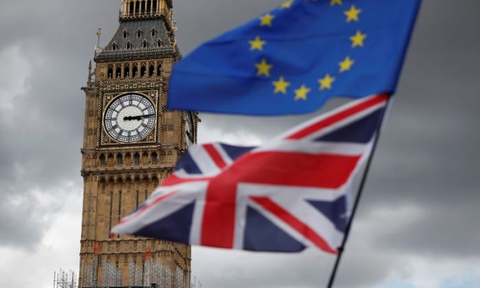 The Union Flag and a European Union flag fly near the Elizabeth Tower, housing the Big Ben bell in Parliament Square in central London, Britain Sept. 9, 2017.   (Reuters/Tolga Akmen)