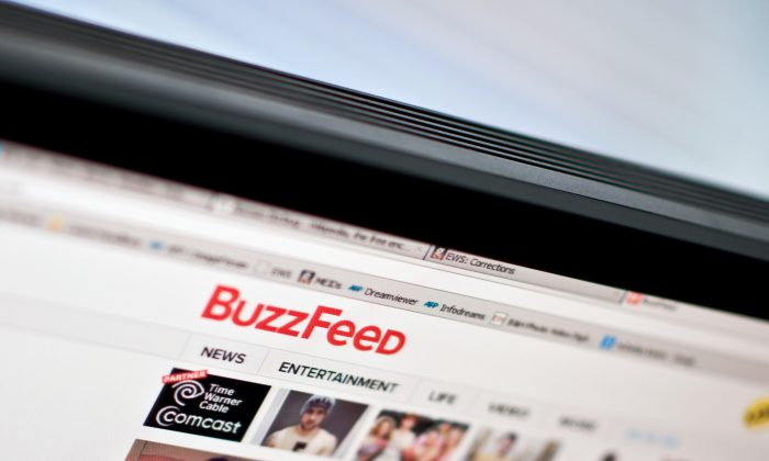 The logo of news website BuzzFeed is seen on a computer screen in Washington on March 25, 2014. (NICHOLAS KAMM/AFP/Getty Images)
