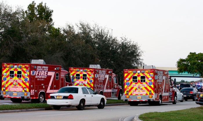 Fire Rescue vehicles block the road to Marjory Stoneman Douglas High School in Parkland, Fla., on Feb. 14, 2018, following a school shooting. (Rhona Wise/AFP/Getty Images)
