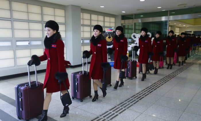 North Korean cheering squads arrive at the Korean transit office near the Demilitarized Zone on Feb. 7, 2018, in Paju, South Korea. (Ahn Young-joon/Pool/Getty Images)