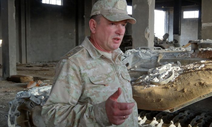 Lt.-Gen. Alexander Lapin, chief of staff of Russia's contingent in Syria, speaks to journalists from inside a destroyed warehouse used by ISIS. (Maria Antonova/AFP/Getty Images)