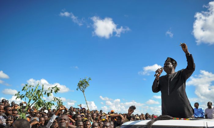 Opposition leader Raila Odinga gives an address to his supporters during demonstrations in the Umoja subururb of Nairobi on Nov. 28, 2017, following a denial of permission by police to the National Super Alliance (NASA) leader to hold a rally concurrently to the inauguration of the country's new president. (Tony Karumba/AFP/Getty Images)