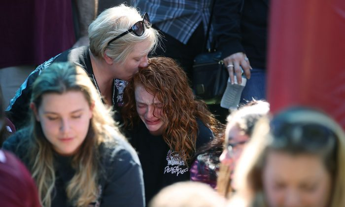 Alyssa Kramer (C), a Marjory Stoneman Douglas High School student, is comforted by her mother Tonja Kramer during a prayer vigil on Feb. 15, 2018, in Parkland, Fa., one day after a mass shooting took place at the school. (Mark Wilson/Getty Images)