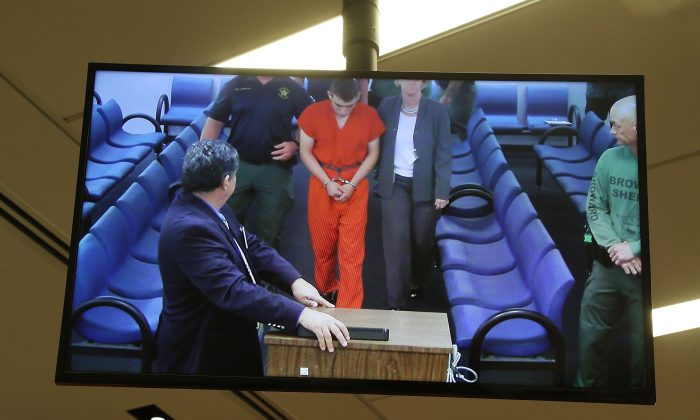 Nikolas Cruz, 19, a former student at Marjory Stoneman Douglas High School in Parkland, Florida, where he allegedly killed 17 people, is seen on a closed circuit television screen during a bond  hearing in front of Broward Judge Kim Mollica at the Broward County Courthouse in Fort Lauderdale, Florida on Feb. 15, 2018. Mr. Cruz is possibly facing 17 counts of premeditated murder in the school shooting.  (Photo by Susan Stocker - Pool/Getty Images)