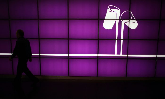An employee walks past company branding at the Cadbury's Bournville production plant on Dec. 15, 2009 in Birmingham, England. (Christopher Furlong/Getty Images)