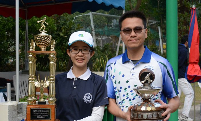 Tony Cheung (R) and Angel So showing their Champion of Champions trophy after prevailed in their respective finals last Sunday (Feb 11). (Stephanie Worth)