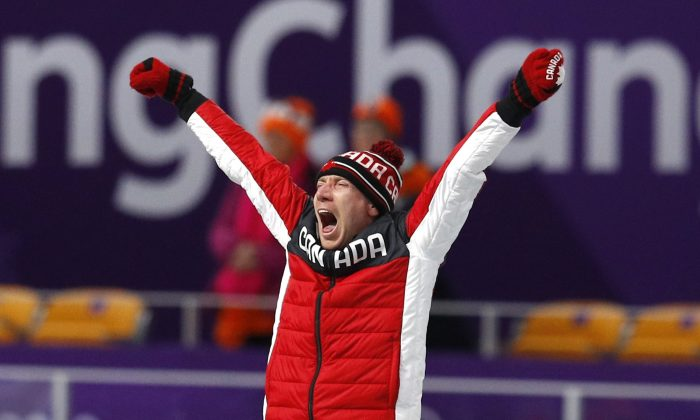 Ted-Jan Bloemen celebrates his gold medal win at the men's 10,000m speed skating competition during the Pyeongchang 2018 Winter Olympics games in Gangneung, South Korea on Feb. 15, 2018. (Reuters/Phil Noble)