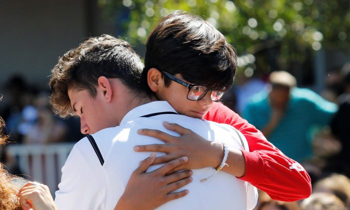 Students from Marjory Stoneman Douglas High School attend a memorial following a school shooting in Parkland, Florida, U.S., February 15, 2018.  (REUTERS/Thom Baur)