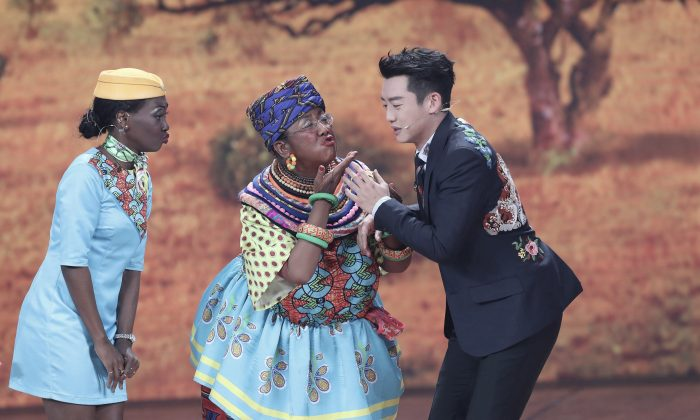 Chinese actress Lou Naiming (C) performs a blackface skit that viewers have accused as racist, at the Lunar New Year gala in Beijing, China, on February 15, 2018. (Stringer/Reuters)