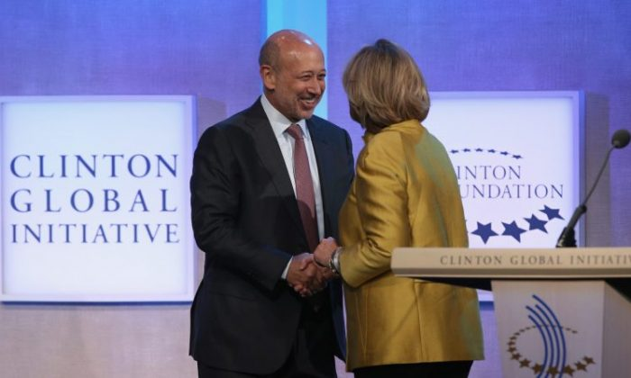 Goldman Sachs Chairman and CEO Lloyd Blankfein is greeted by former U.S. Secretary of State Hillary Clinton at the Clinton Global Initiative (CGI), in New York City on Sept. 24, 2014.