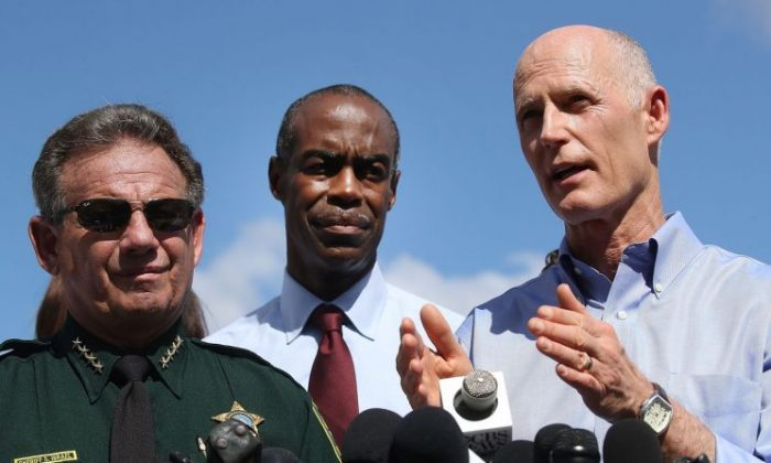 Florida Governor Rick Scott (R), Broward County Superintendent of Schools, Robert W. Runcie (C) and Broward County Sheriff, Scott Israel (L) speak to the media about the mass shooting at Marjory Stoneman Douglas High School where 17 people were killed yesterday in Parkland, Florida on Feb. 15, 2018. (Mark Wilson/Getty Images)