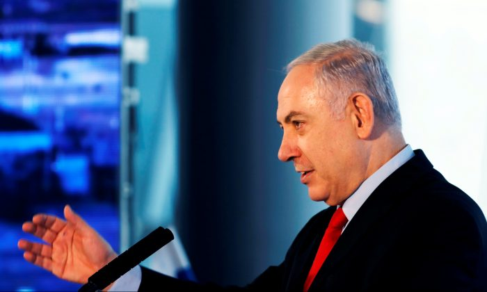 Israeli Prime Minister Benjamin Netanyahu speaks during the dedication ceremony of a new concourse at the Ben Gurion International Airport, near Lod, Israel Feb. 15, 2018. (Reuters/Ronen Zvulun)