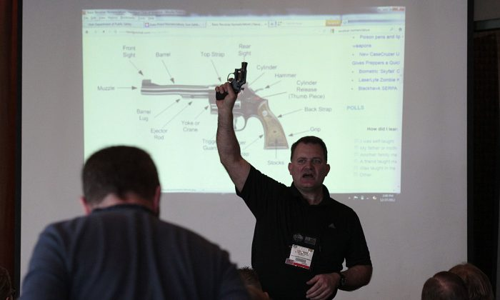Firearm instructor Clark Aposhian teaches a concealed-weapons training class to 200 Utah teachers in West Valley City, Utah on Dec. 27, 2012. (Photo by George Frey/Getty Images)