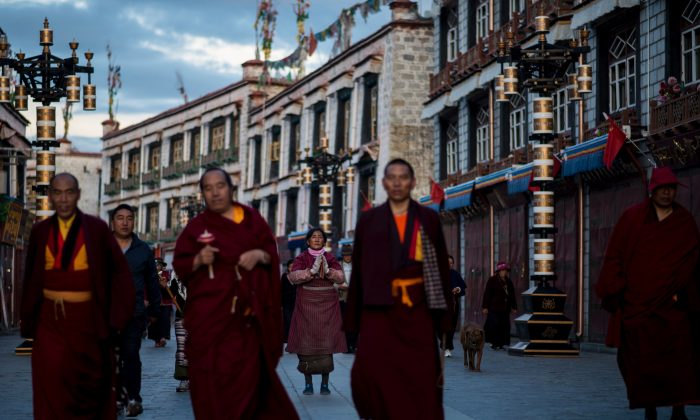 Pilgrims praying and prostrating outside the Jokhang Temple in the capital of Lhasa, Tibet, on September 11, 2016.(Johannes Eisele/AFP/Getty Images)