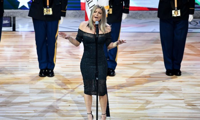 Singer Fergie sings the national anthem prior to The 67th NBA All-Star Game: Team LeBron Vs. Team Stephen at Staples Center in Los Angeles on Feb. 18, 2018.  (Allen Berezovsky/Getty Images)