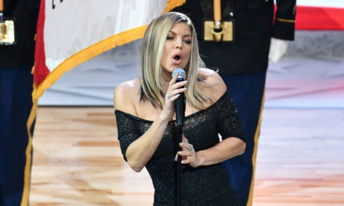 Singer Fergie sings the national anthem prior to The 67th NBA All-Star Game: Team LeBron Vs. Team Stephen at Staples Center in Los Angeles on Feb. 18, 2018. (Photo by Allen Berezovsky/Getty Images)