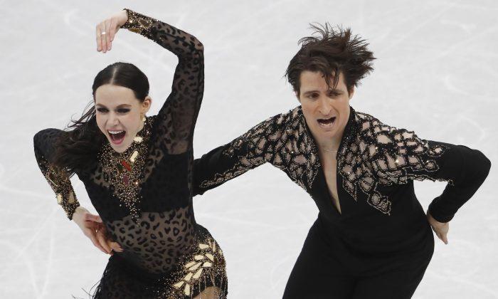 Tessa Virtue andScottMoirof Canada perform during the Ice Pyeongchang 2018 Winter Olympics ice dance short dance competition on Feb. 19, 2018. (Reuters/Damir Sagolj)