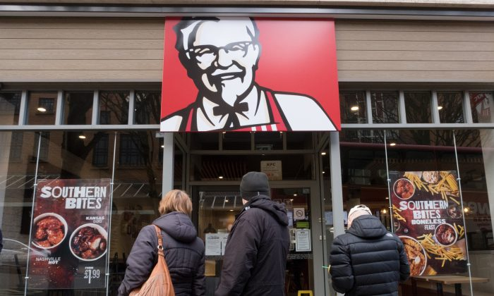 People look into a branch of KFC that is closed due to problems with the delivery of chicken on Feb. 20, 2018, in Bristol, England. (Matt Cardy/Getty Images)