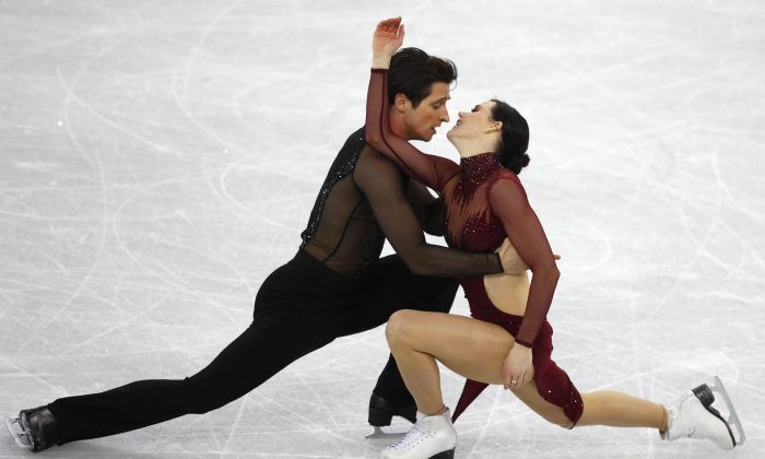 Tessa Virtue and Scott Moir perform at the ice dance free dance competition during the Pyeongchang 2018 Winter Olympics on Feb. 20, 2018. (Reuters/Phil Noble)