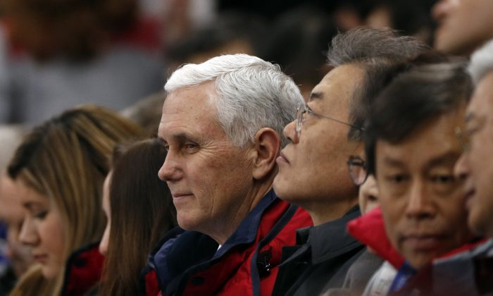 U.S. Vice President Mike Pence and South Korea's President Moon Jae-in attend short track speed skating events at the Gangneung Ice Arena in South Korea, Feb. 10, 2018. (Reuters/John Sibley)