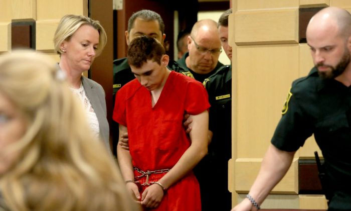 Nikolas Cruz appears in court with attorney Melissa McNeil (L) for a status hearing before Broward Circuit Judge Elizabeth Scherer on Feb. 19, 2018, in Fort Lauderdale, Fla. (Mike Stocker-Pool/Getty Images)