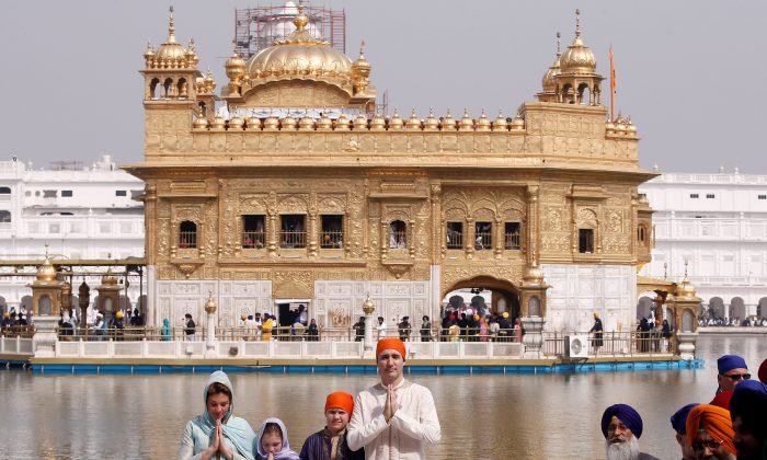 Canadian Prime MinisterJustinTrudeau, his wife Sophie Gregoire, daughter Ella Grace, and son Xavier pose for photographers during their visit to the holy Sikh shrine of Golden temple in Amritsar, India on Feb. 21, 2018. (Reuters/Adnan Abidi)