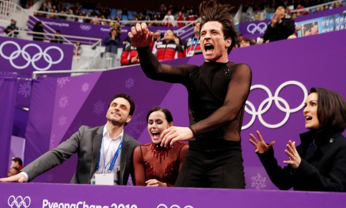 Tessa Virtue and Scott Moir react after their performance at the ice dance free dance competition final during the Pyeongchang 2018 Winter Olympics. (Reuters/John Sibley)