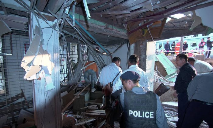 Officials inspect the damage after a bomb blast in Lashio, Burma Feb. 21, 2018 in this picture obtained from social media. (Ministry of Information Webportal Myanmar/via Reuters)