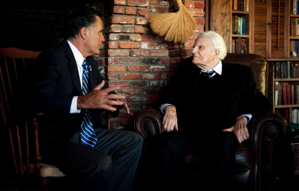 U.S. Republican presidential candidate Mitt Romney (L) speaks with the Reverend Billy Graham during a visit to the Graham cabin in Montreat, N.C., on Oct. 11, 2012. (Jim Watson/AFP/Getty Images)