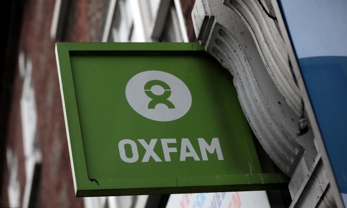 A sign is seen above a branch of Oxfam, in central London, Britain February 13, 2018. (Reuters/Simon Dawson)