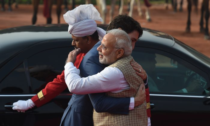 India's Prime Minister Narendra Modi (R) embraces Canada's Prime Minister Justin Trudeau during a ceremonial reception at the Presidential Palace in New Delhi on Feb. 23, 2018.