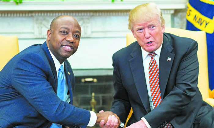 Sen. Tim Scott (R-S.C.) and President Donald Trump shake hands during a working session regarding Opportunity Zones following the recently signed tax bill at the White House on Feb. 14. (MANDEL NGAN/AFP/GETTY IMAGES