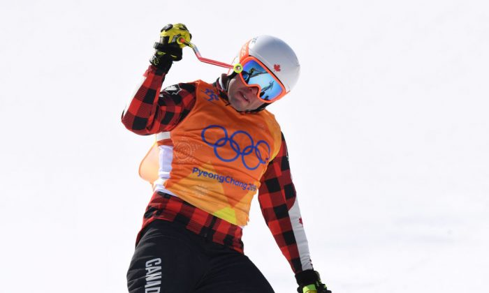 Dave Duncan of Canada, celebrates after winning heat 7 in the Freestyle Skiing Men's Ski Cross 1/8 finals on day 12 of the PyeongChang 2018 Winter Olympic Games at Phoenix Snow Park in Pyeongchang-gun, South Korea on Feb. 21, 2018. (Photo by David Ramos/Getty Images)