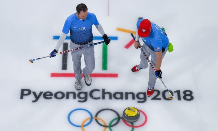 Team USA competes during the curling men's gold medal game between the USA and Sweden during the Pyeongchang 2018 Winter Olympic Games at the Gangneung Curling Centre in Gangneung on Feb. 24, 2018. Francois-Xavier Marit/AFP/Getty Images)