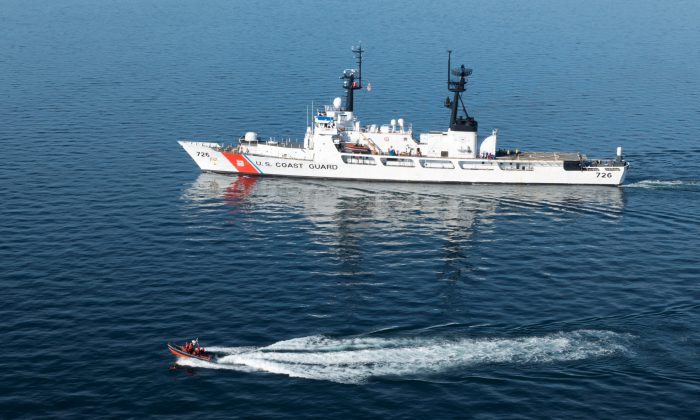 The Coast Guard Cutter Midgett, a 378-foot high-endurance cutter homeported in Seattle, transits the Strait of Juan de Fuca enroute to Seattle, Washington, U.S. in this Oct. 13, 2015. (Petty Officer 1st Class Levi Read/U.S. Coast Guard/Handout via Reuters)