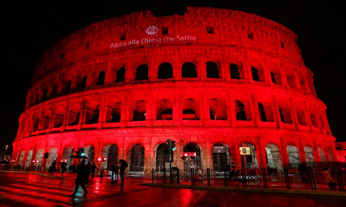 The Colosseum is lit up in red to draw attention to the persecution of Christians around the world in Rome, Italy, Feb. 24, 2018.  (Reuters/Remo Casilli)
