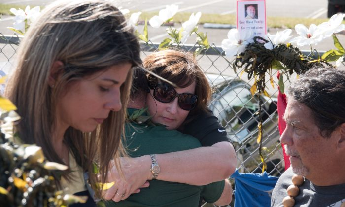 Parkland Mayor Christine Hunschofsky receives a hug as she and other government officials mourn, as students and parents arrive for voluntary campus orientation at the Marjory Stoneman Douglas High School, Feb. 25, 2018. (Reuters/Angel Valentin)