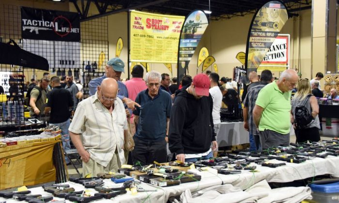 Gun enthusiasts attend the South Florida Gun Show at Dade County Youth Fairgrounds in Miami, Florida, on February 17, 2018. (MICHELE EVE SANDBERG/AFP/Getty Images)