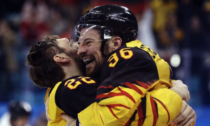 Matthias Plachta and Yannic Seidenberg of Germany celebrate their victory over Canada in the semifinals of the Olympic men's ice hockey tournament in Pyeongchang, South Korea on Feb. 23, 2018. (Reuters/David W Cerny)