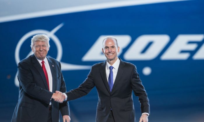 President Donald Trump, is introduced by Boeing's chief executive officer Dennis Muilenburg during the debut event for the Dreamliner 787-10 at Boeing's South Carolina facilities on February 17, 2017 in North Charleston, South Carolina. (Sean Rayford/Getty Images)