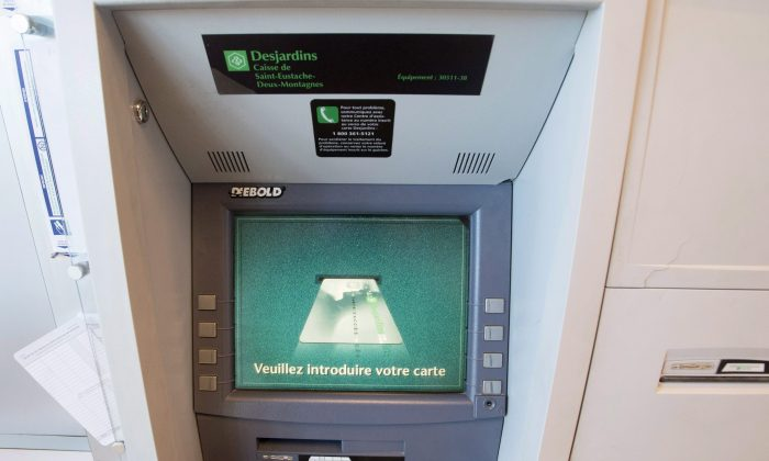 A Caisse Desjardins ATM in Montreal. Desjardins has announced plans to close dozens of ATMs in outlying regions of the province. (The Canadian Press/Ryan Remiorz)