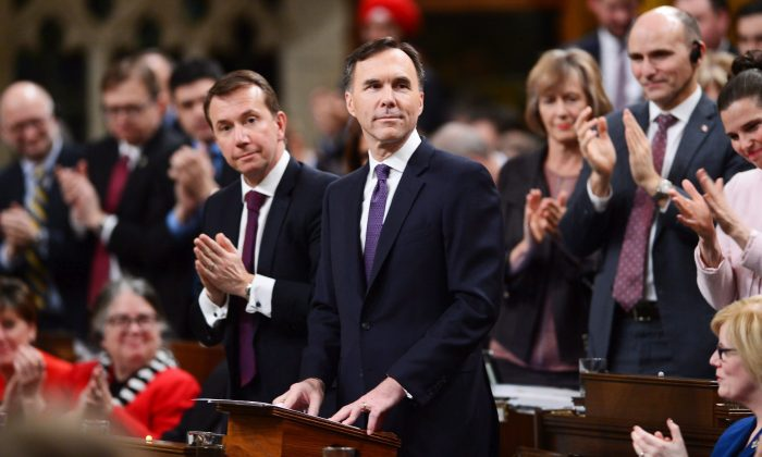 Finance Minister Bill Morneau receives a round of applause after delivering the federal budget in the House of Commons on Feb. 27, 2018. (The Canadian Press/Sean Kilpatrick)
