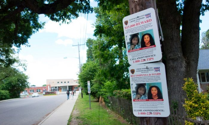 A reward poster on a telephone pole near the local high school, asking for help in finding the killers of Nisa Mickens and Kayl Cuevas June 7, 2017, in Brentwood, N.Y. (Don Emmert/AFP/Getty Images)